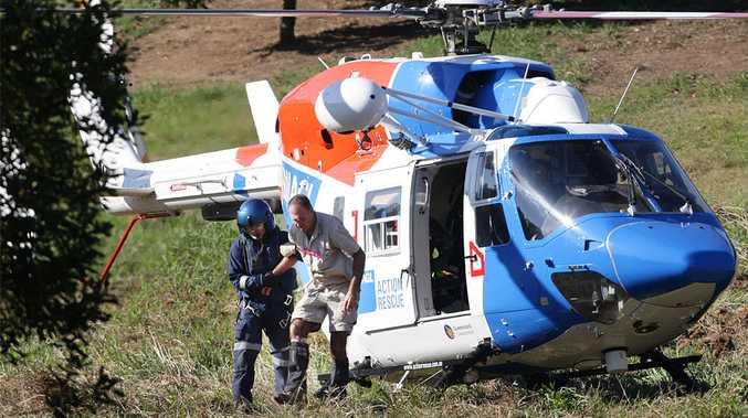 A bushwalker is helped after being rescued off Mt Beerwah.