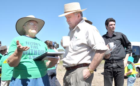 Felton resident Iris Bryce briefs Senator John Williams on the location of the proposed project. Senator Scott Ludlam (at rear) receives similar information from other members of the group.