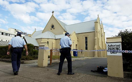 Police close off the St Mary's churchyard following the discovery of Wayne Warren Ruks' body. - File photo