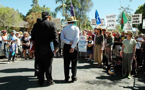 Supporters and opponents of the Mullumbimby Woolworths supermarket face-off during a Land and Environment Court site inspection on Monday.
