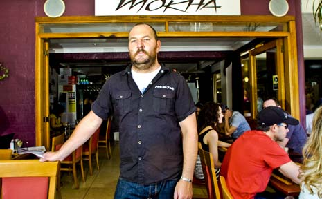 Adam Irwin, owner of Cafe Mokha in Byron Bay, supports a plan from Tweed mayor Warren Polglase for a single summer time zone covering the entire eastern seaboard of Australia.