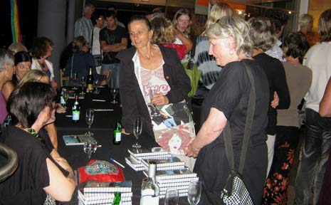A busy artists' signing table at last week's diary launch.