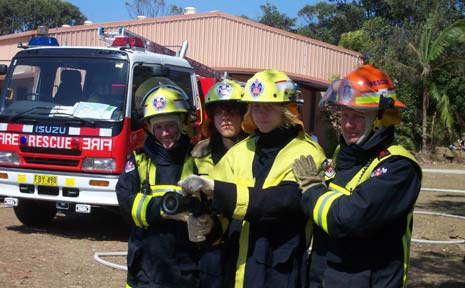 Students and representatives of the NSW Fire Brigade and the NSW Rural Fire Service in full firefighting gear as part of the Byron Shire Fire Services Secondary Schools Program at Byron Bay High School.