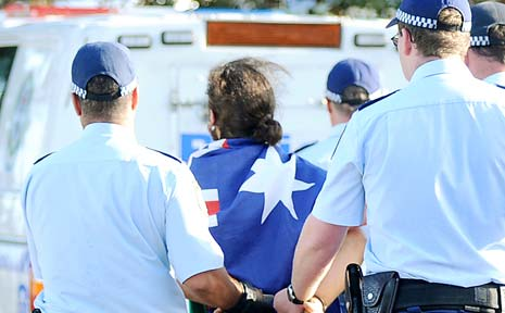 YOUTH UNREST: Police arrest a young man at Lennox Head after fights and scuffles broke out on Australia Day this year.