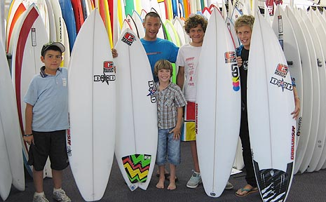 Mechanical surfboard competition winners Jessie Tippett, Joel Stokes, Ziggy Alberts and Michael Cocks receive their boards from Coolum Surf's Jonathan Riviere, middle.