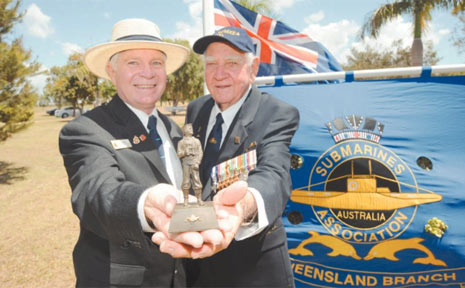 President of the Queensland Submarines Association of Australia Don Currell and veteran Ken Briggs with the state of Able Seaman Reid, which travels around the world. The statue resides in Westminster Abbey.