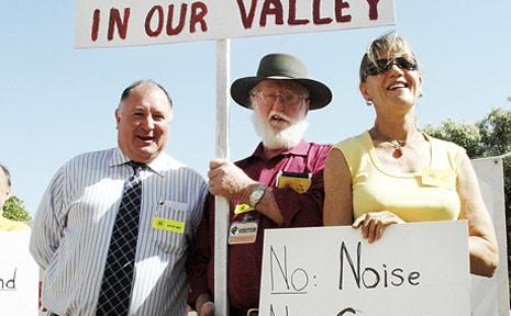 Mayor Steve Jones (left) greets Robert Fowke and Anita Morrison at the council meeting yesterday.