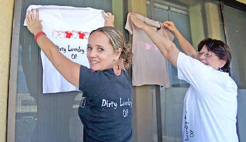 Niki Bellmaine and Karen Coyle airing their dirty laundry.