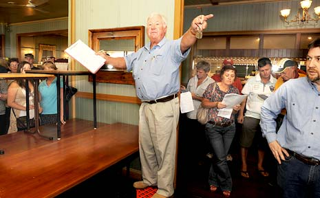 EAGER BIDDERS: Brisbane auctioneers Paul Zoeller and Mark Peel (far right) yesterday accepting bids from the enthusiastic crowd at the Bellowing Bull, Wollongbar.