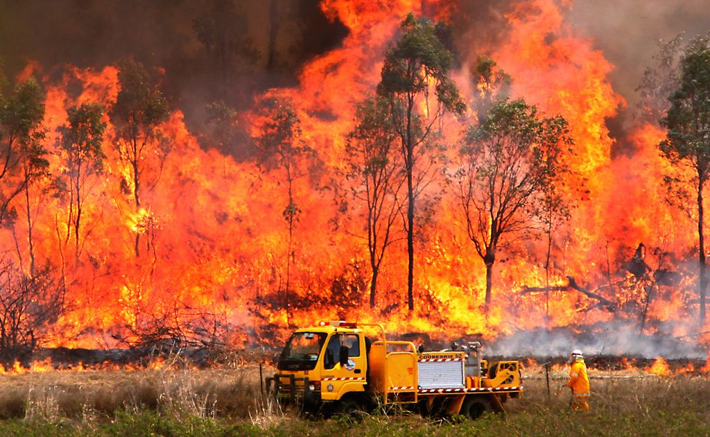 Firefighters work to contain a large bushfire east of Rockhampton.