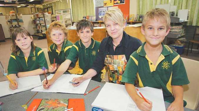 Children's author Narelle Oliver holds a writing workshop for students at Waraburra School. (From left) Sheyan Mason, Reece Jones, Biley Kelly and Simon Hope.