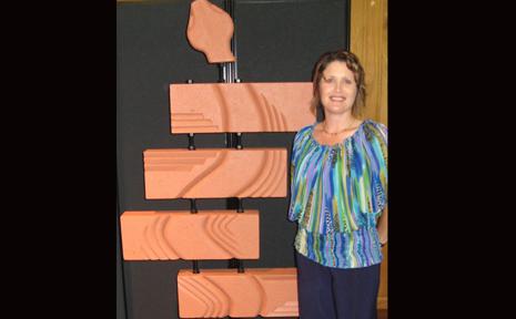 "EYE-CATCHING: The Callide Mine Encouragement award winner Olga Bath and her sculpture ""Adder""."