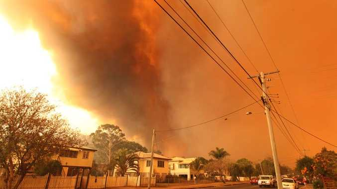 A large fast moving bushfire threatens houses on Rockhampton's outskirts.