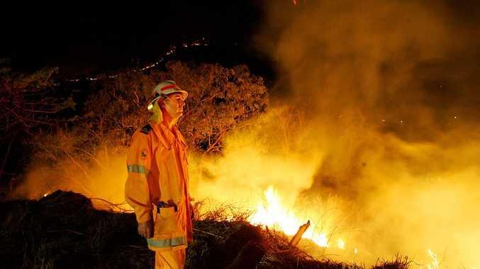 Crews back burn behind their Forbes Avenue home in Rockhampton.