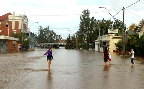 EARLY SIGNS: Floodwaters take their toll on Lismore with waters rising in Bridge Street, North Lismore.