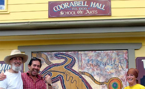 Putting finishing touches to Coorabell Hall are association members (left to right) David Hollingworth, George Lewin and Janet Kneale, in front of the Aboriginal art now gracing the front doors.
