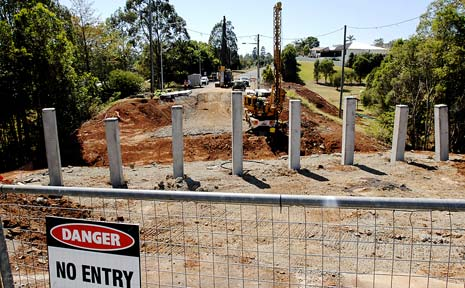 NEW DELAYS: Work to build a new bridge over a storm-damaged section of Oliver Avenue, Goonellabah, came to a sudden standstill this week after workers cut a phone cable.