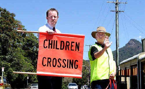 UKI Public School Principal Jeff Robinson and Uki Neighbourhood Watch Co-ordinator Maggie Wilkins-Russel, have urged motorists to slow down as they drive through the village.