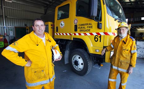 EXHAUSTED: Rural firefighting volunteers Mick Stokes and John Penna enjoy some rest at the Cawarral Rural Fire Shed after fighting fires for 20 of the 26 days flames have blazed in the region.