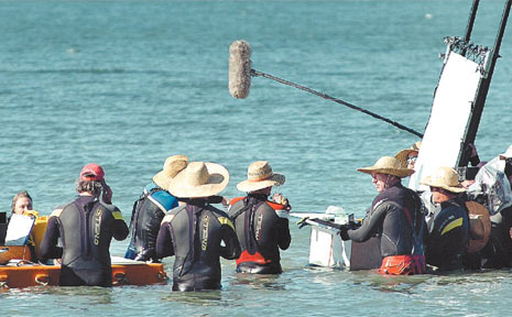 Production crew members have spent days in Hervey Bay waters filming scenes for movie The Reef.