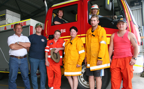 OFF TO THE FRONT: A group of fire figthers and SES ee Snoodyk, Gary Henders, Luke Gannon, Jennifer Games (in truck), Sheryl Bawden, Matthew Kessler, David Baldwin (truck) and Jonathon Wright, went and helped fight the Rockhampton fires on Wednesday.