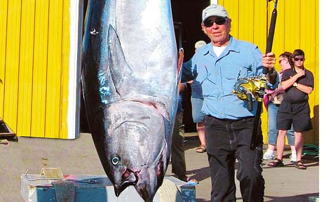 MONSTER CATCH: Former Lismore man Dennis Braid with the 363kg bluefin tuna he caught in waters off the east coast of Canada last year. Two weeks ago he topped that effort with a 550kg fish.