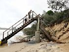 The scene at Mooloolaba earlier this year when big seas generated by Cyclone Hamish carved out sand dunes and brought down stairways and lifeguard towers.