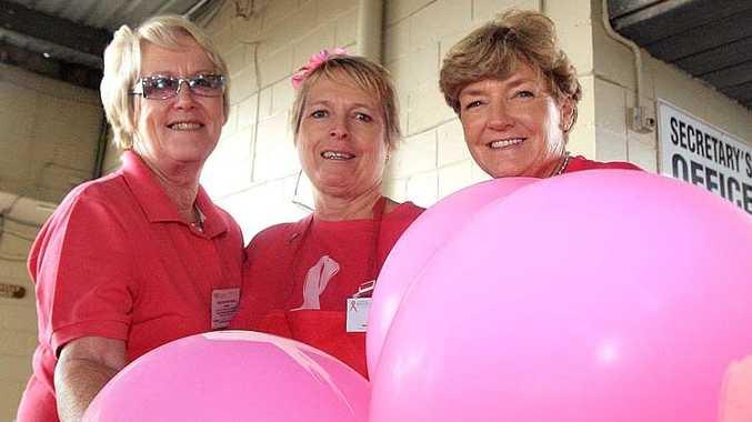 Pink Ribbon Day volunteers Di Black, Pat Kerr and Barb Brosnan helped raise money at the Tweed River Jockey Club yesterday.