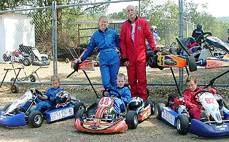 THREE GENERATIONS: Barry Fisher with grandsons (from left) Kurt Nommensen, Ryan Newell and Dmitri Nommensen, and Fisher's daughter Jodie Nommensen, who all are involved in kart racing.