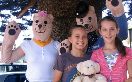 Lilli Farrell (left) and Shani Lloyd, pictured here with Mamma and Poppa Bear, were two of the 200 or so children to enjoy all the fun and games at last Saturday's Teddy Bears' Picnic at Brunswick Heads.