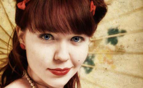 Kat Creasey models some of her rockabilly-inspired jewellery designs and hair accessories.