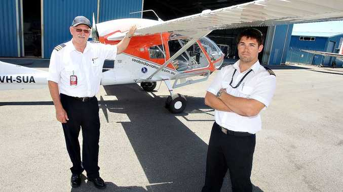 Marine Watch director Glenn-Leigh Smith with fellow pilot Paul Davidson and the Seabird.