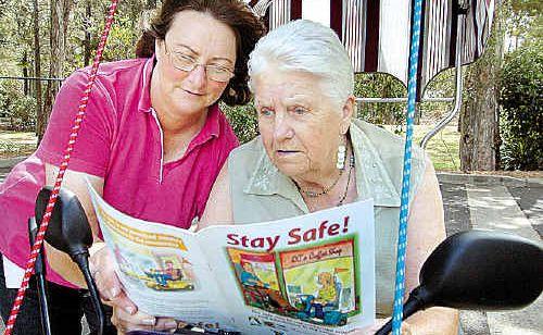Julie de Waard (left) and Mavis Jenkins discuss the importance of scooter safety.