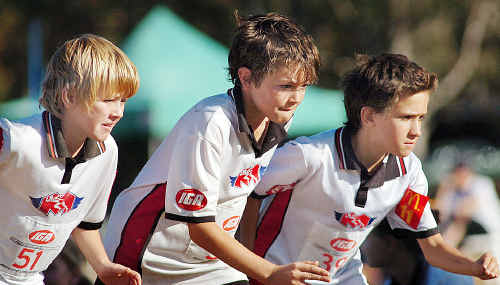 Set for a start in the boys under-11s 800m are Maryborough runners Lachlan Kruger, Coen Watts and James Nagle.