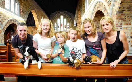 From left, Chris Clark with Belle, Kaitlyn Pratten (13), Jonas Clark (8), Isaac Clark (10), Hollie Clark (12), and Susan Clark (with their furry friends), all of Goonellabah, at the Blessing of the Pets at St Andrews in Lismore.