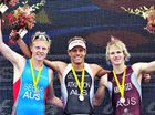 Noosa triathlon champion Courtney Atkinson, centre, is flanked by runner-up James Seear and third-place finisher Josh Amberger.