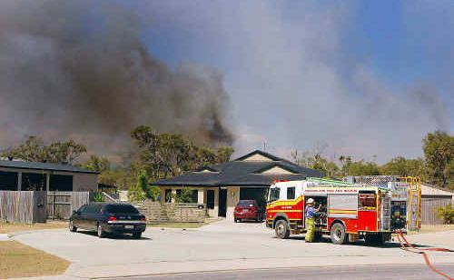 Residents of the remote suburb busily hosed down their properties to save them from flames.
