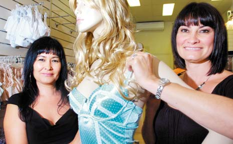 New owners of the new look Jeanettes, Kim Mackerras and Sheree McDonald, prepare for the opening of their shop.