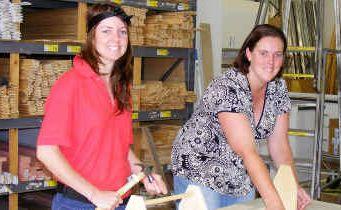 Bunnings Warehouse team member Julia Bailey and community co-ordinator Karen Lowe get ready to teach women important DIY skills.