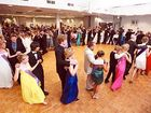 Queen candidates and partners, as well as official guests, dancing the Pride of Erin at the Jacaranda Ball.