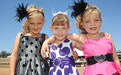 Deja Humphreys, Madison Sherratt and Maddison Smith prove kids make the cut in th fashion stakes. Photo: Max Fleet.