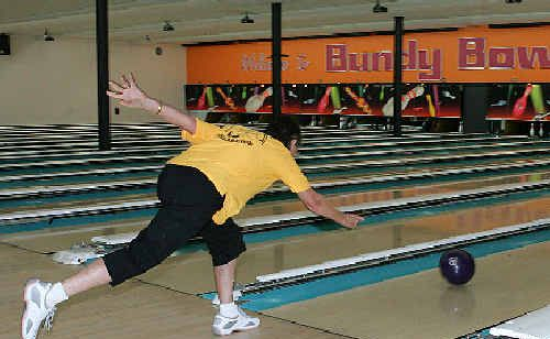 Bundaberg ten pin bowler Jan Glasgow sends her bowl on its way for a strike.