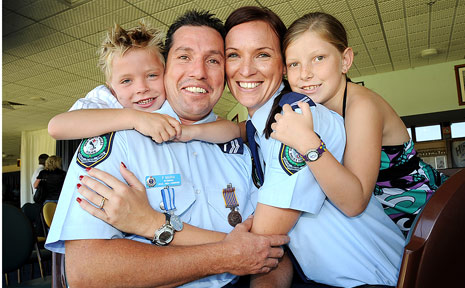 Thomas, 6, and Ashlee Maria, 7, show their pride in their dad and step mum, Snr Const Phillip Maria and Snr Const Amanda Crouch, after yesterday's police awards.