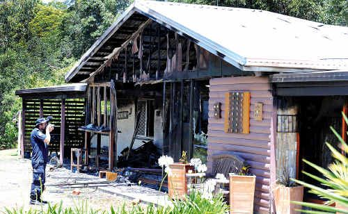Police at the scene of the house fire at Camp Flat Road, Bli Bli.