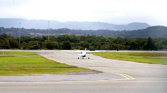 A light plane taxis along the runway at the Gold Coast Airport where a Cessna plane crashed earlier today.
