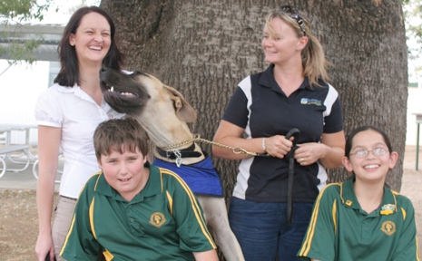 GONE TO THE DOGS:Angus the dog thanks Amanda Pollard from the Australian Veterinary Association, Donna Burnett local laws compliance officer, Jacob McLeod school captain and Danilie Brown vice-captain for delivering the responsible pet owners program at Banana State School last week. Picture by Stacey Rudd.