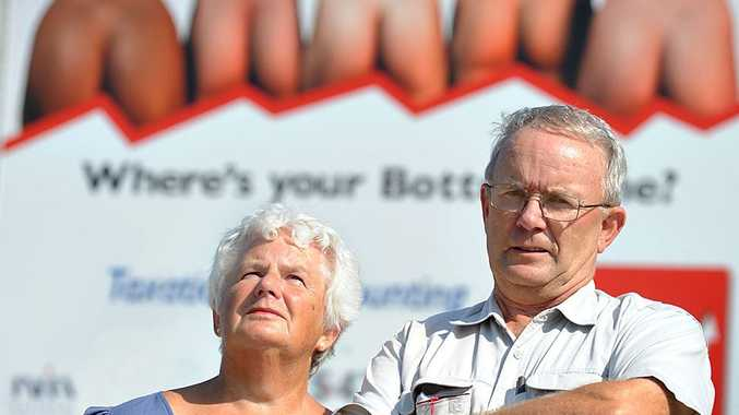 OUTRAGED: Paul and Pauline Nicholas are downright disgusted and horrified by the use of bottoms in this advertisement at Coolum.
