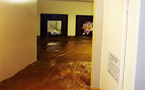 The lobby of Creek Towers in Coffs Harbour is inundated with floodwater at 10pm on Friday night.  The water level can be identified by the pictures hanging on the back wall at head height.