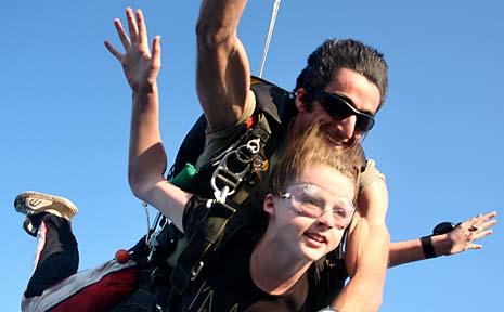 Tandem skydive expert Alby Moses makes his final jump with daughter Maya.