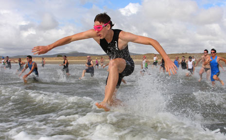 SUNDAY STRENGTH: Fin Turley leads competitors into the water for the 750m swim and continues his strong lead throughout the remainder of the race at the weekend.